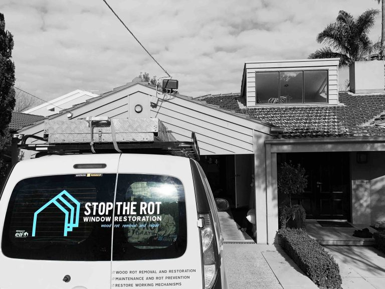 stop-the-rot-van-outside-house